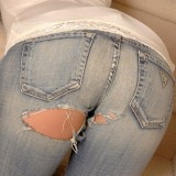 Carmen bends over and shows off her round ass in a tight pair of jeans